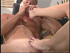 Guy sucks brunette's toes and gets foot job