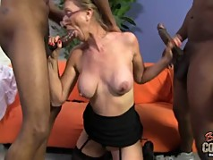Granny Jenna takes two black cocks at once