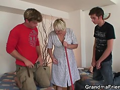 Blonde old grandma takes two cocks