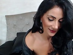 Raven Haired Milf Teasing In Sexy Leather Outfit