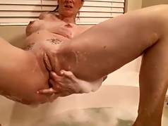 Whootylicious busty housewife takes bath and masturbates