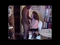 Older milf is going for it, and sucking black cock